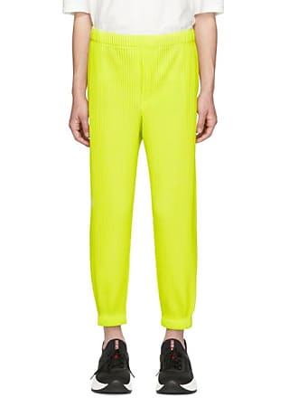 d6ffec14f Homme Plissé Issey Miyake Yellow Tapered Pleat Trousers