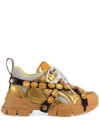 d97b3c200 Gucci Tênis Flashtrek de couro com aplicações - Dourado