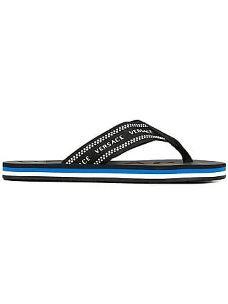 8fc76e61ebe4f Versace logo print flip flops - Black