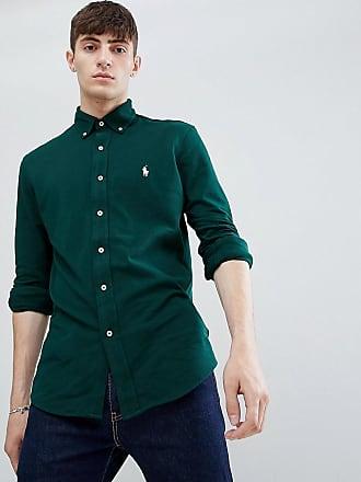 7bda2ee89a69c Polo Ralph Lauren Camisa de piqué de corte slim en verde oscuro con botones  y logo