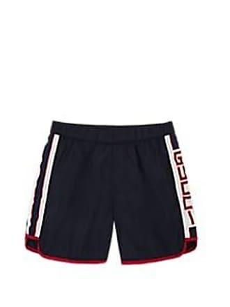 5eb9ea78ee30d Gucci Kids Logo-Striped Tech-Taffeta Swim Trunks - Navy Size 10 YRS