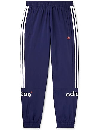 best loved 17b1c 18879 adidas Originals Arc Tapered Logo-embroidered Striped Shell Track Pants -  Blue