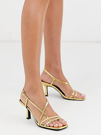"""Image result for RAID Exclusive Aadhya strappy heeled sandals in gold"""""""