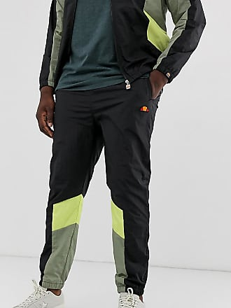 56a209cfb4 Ellesse Plus - Jose - Joggers neri con verde e giallo - Nero