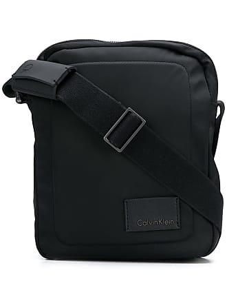 9a8af4be9 Calvin Klein Bolsa transversal pequena com logo - Preto