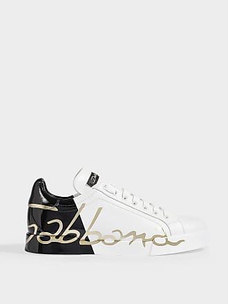f53b94cfafdd Dolce & Gabbana Portofino Sneakers with Logo across Rear in Black, White  and Gold Calfskin