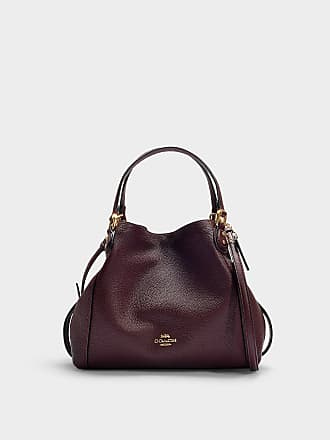 33f1d673e54a00 Delivery: free. Coach Polished Pebble Leather Edie 28 Shoulder Bag in  Burgundy Calfskin