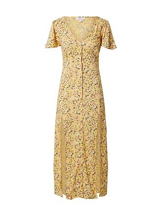 Nora Grön lång klänning med volangkant i botten och på ärmarna